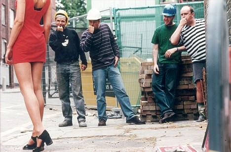 CONSTRUCTION WORKERS EYEING UP LONG LEGGED GIRL AS SHE WALKS PAS